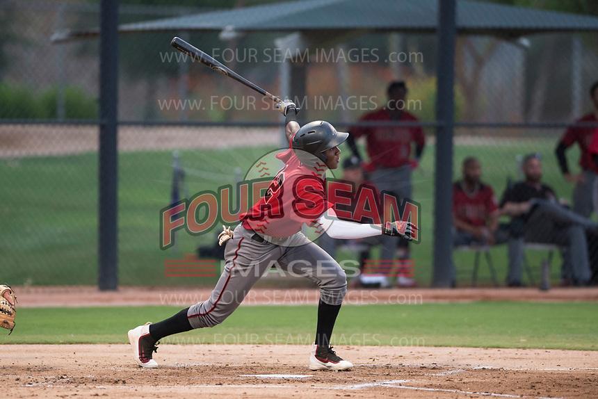 AZL Diamondbacks shortstop Geraldo Perdomo (12) follows through on his swing during an Arizona League game against the AZL White Sox at Camelback Ranch on July 12, 2018 in Glendale, Arizona. The AZL Diamondbacks defeated the AZL White Sox 5-1. (Zachary Lucy/Four Seam Images)