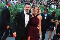 Scott Cooper, left, and his wife Jocelyne Cooper attend the red carpet for the movie 'Black Mass' during 72nd Venice Film Festival at the Palazzo Del Cinema in Venice, Italy, September 4, 2015. <br /> UPDATE IMAGES PRESS/Stephen Richie