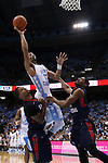 16 November 2014: North Carolina's J.P. Tokoto (13) shoots over Robert Morris's Charles Oliver (left) and Rodney Pryor (right). The University of North Carolina Tar Heels played the Robert Morris University Colonials in an NCAA Division I Men's basketball game at the Dean E. Smith Center in Chapel Hill, North Carolina. UNC won the game 103-59.