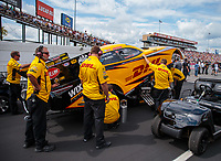 Sep 1, 2018; Clermont, IN, USA; Crew members stand alongside the car of NHRA funny car driver J.R. Todd during qualifying for the US Nationals at Lucas Oil Raceway. Mandatory Credit: Mark J. Rebilas-USA TODAY Sports