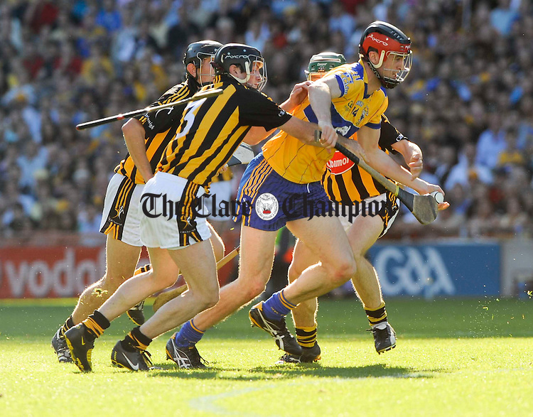 Darach Honan of Clare is tackled by Kilkenny's Paddy Nolan during their U-21 GAA All-Ireland final at Croke Park. Photograph by John Kelly.