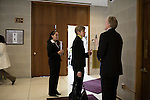 March 17, 2009. Raleigh, NC.. Images from one day in the life of Deborah K. Ross, Representative for North Carolina House District 38.. 10:56 AM. Ross walks through a hallway of the legislature while talking to staff and colleagues on her way to a meeting of the education committee..Her intern, Jezzette Rivera, left, follows along.