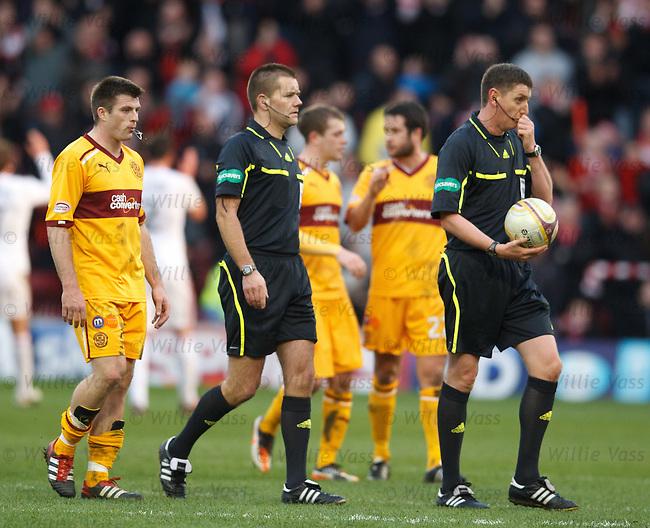 Referee Craig Thomson and linesman Alasdair Ross
