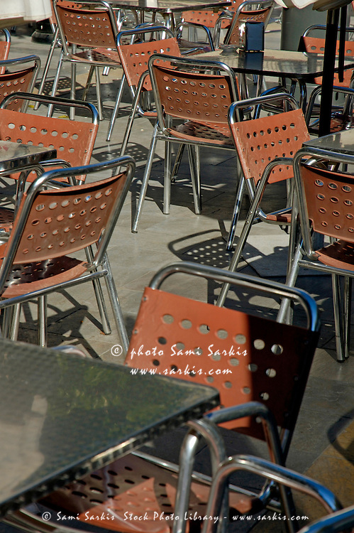 Empty metallic chairs on a cafe terrace, Seville, Andalusia, Spain.