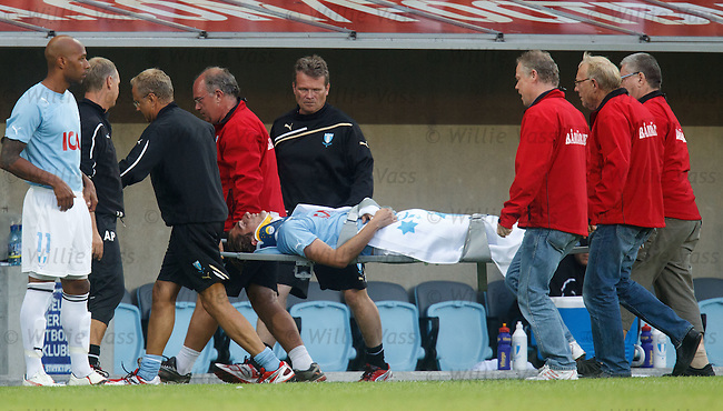 Dardan Rexhepi leaves on a stretcher