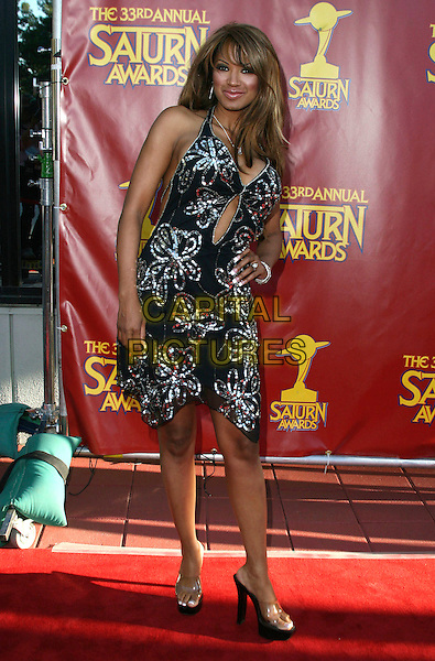 TRACI BINGHAM.33rd Annual Saturn Awards presented by the Academy Of Science Fiction, Fantasy and Horror Films held at the Universal City Hilton Hotel,Universal City, California, USA, 10 May 2007..full length black and silver beaded dress platform perspex shoes hand on hip.CAP/ADM/CH.©Charles Harris/AdMedia/Capital Pictures.