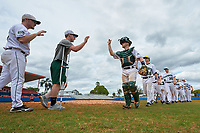 Dartmouth Big Green players - including Beau Sulser (left), catcher Rob Emery, Chris Burkholder (16), and Jack Fossand (30) - celebrate after a game against the Lehigh Mountain Hawks on March 20, 2016 at Chain of Lakes Stadium in Winter Haven, Florida.  Dartmouth defeated Lehigh 5-4.  (Mike Janes/Four Seam Images)