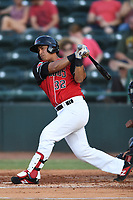 Melvin Novoa (32) of the Hickory Crawdads follows through on his swing during a game against the West Virginia Power at L.P. Frans Stadium on July 25, 2019 in Hickory, North Carolina. The Power defeated the Crawdads 3-2. (Tracy Proffitt/Four Seam Images)