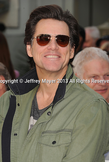 HOLLYWOOD, CA- APRIL 27: Actor Jim Carrey attends actress Jane Fonda's Handprint/Footprint Ceremony during the 2013 TCM Classic Film Festival at TCL Chinese Theatre on April 27, 2013 in Los Angeles, California.