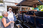 WOODBURY, CT. 16 July 2019-071619 - Don Bourdon of Woodstock, Vermont, right, sits in his 1912 Stanley Steamer model 87, as he talks to Collie Harris, left, and Michael Lang, both of Woodbury at the Hotchkissville Firehouse in Woodbury on Tuesday. A large group of owners of Stanley Steamers from around the country have gathered driving around the area touring the Litchfield Hills. Bill Shettle Republican-American