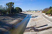 Ballona Creek is a nine-mile long flood protection channel that drains the Los Angeles basin. Ballona Creek is designed to discharge to Santa Monica Bay approximately 71,400 cubic feet per second from a 50-year frequency storm event. Culver City, Los Angeles, California, USA