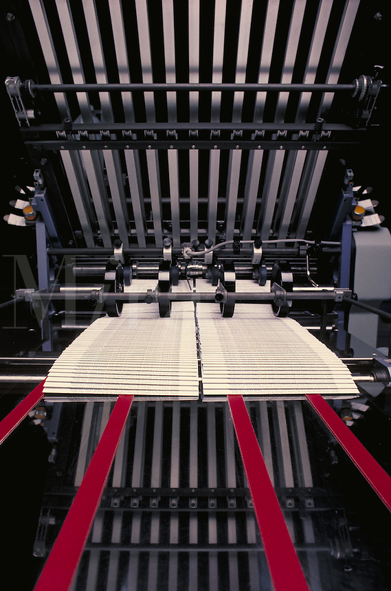 Machine that folds brochures used in the printing industry. Houston Texas.