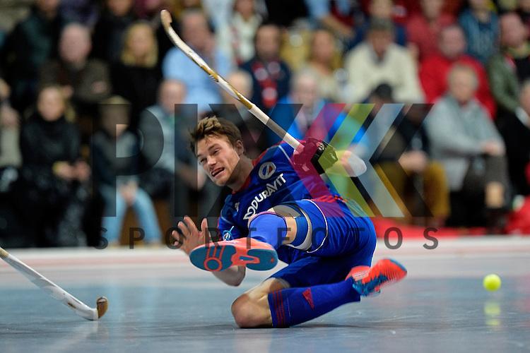 GER - Mannheim, Germany, December 12: During the 1. Bundesliga Sued Herren indoor hockey match between Mannheimer HC (blue) and TSV Mannheim (red) on December 12, 2015 at Irma-Roechling-Halle in Mannheim, Germany. Final score 5-0 (HT 1-0). Maximilian Neumann #24 of Mannheimer HC<br /> <br /> Foto &copy; PIX-Sportfotos *** Foto ist honorarpflichtig! *** Auf Anfrage in hoeherer Qualitaet/Aufloesung. Belegexemplar erbeten. Veroeffentlichung ausschliesslich fuer journalistisch-publizistische Zwecke. For editorial use only.