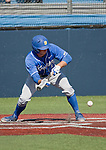 March 10, 2012:   UC Santa Barbara Gauchos  Ryan Palermo lays down a bunt against the Nevada Wolf Pack during their NCAA baseball game played at Peccole Park on Saturday afternoon in Reno, Nevada.