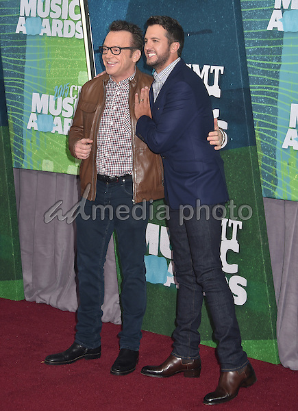 10 June 2015 - Nashville, Tennessee - Luke Bryan, Tom Arnold. 2015 CMT Music Awards held at Bridgestone Arena. Photo Credit: Laura Farr/AdMedia