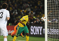 In one of South Africa's best scoring chances, forward Katlego Mphela pushes a header just past the hands of goalkeeper Fernando Muslera, but wide of the goal. Uruguay defeated South Africa, 2-0, in both teams' second match of play in Group A of the 2010 FIFA World Cup. The match was played at Loftus Versfeld in Pretoria, South Africa June 16th.
