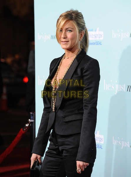 "JENNIFER ANISTON.""He's Just Not That Into You"" Los Angeles Premiere at Grauman's Chinese Theatre, Hollywood, California, USA..February 2nd, 2009.half length black trouser suit pant jacket blazer gold jewellery necklaces tux tuxedo blazer clutch bag .CAP/DVS.©Debbie VanStory/Capital Pictures."
