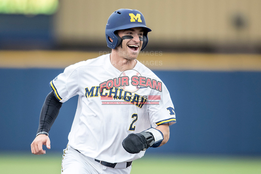 Michigan Wolverines outfielder Jonathan Engelmann (2) celebrates as he jogs around the bases against the Maryland Terrapins on April 13, 2018 in a Big Ten NCAA baseball game at Ray Fisher Stadium in Ann Arbor, Michigan. Michigan defeated Maryland 10-4. (Andrew Woolley/Four Seam Images)