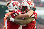 Wisconsin Badgers wide receiver Jared Abbrederis (4) celebrates his touchdown with teammate James White (20) during an NCAA Big Ten Conference Football game against the Indiana Hoosiers Saturday, November 16, 2013, in Madison, Wis. The Badgers won 51-3. (Photo by David Stluka)