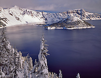 Crater Lake and Wizard Island with snow. Crate Lake National Park, Oregon.