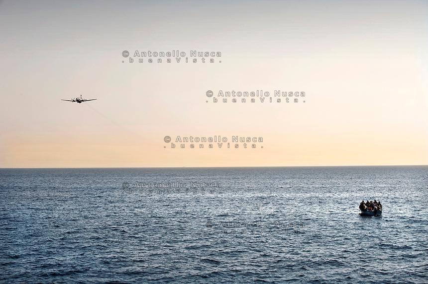 Lampedusa,2011. Uomini della Capitaneria di Porto impegnati nelle operazioni di ricerca e salvataggio di immigrati.<br /> A boat of african immigrants in the meadle of Mediterranean sea