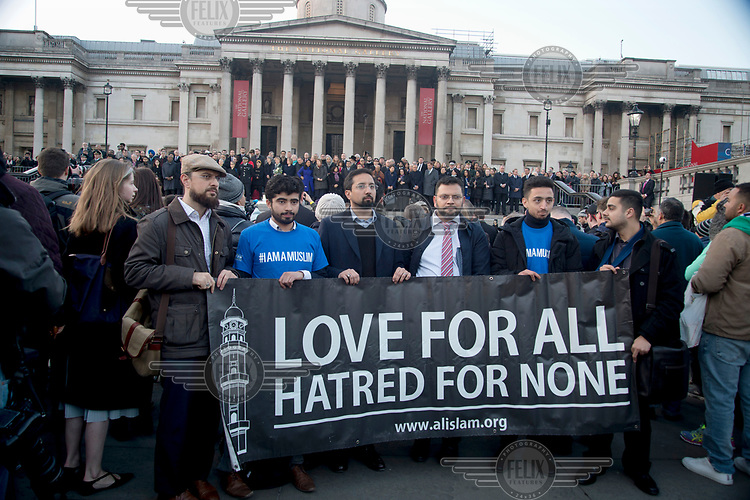 A group of Muslims from Merton mosque in South London hold a banner which reads: 'Love for all, hatred for none' at a vigil in Trafalgar Square for victims of 22 March 2017 Westminster terror attack.