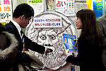 """February 7, 2013, Tokyo, Japan - A man puts his hand inside """"La Bocca Della Verita"""" stone. The 75th Tokyo International Gift Show (TIGS) is an exhibition of personal gifts, consumer goods and decorative accessories. The TIGS is the largest International Trade Show in Japan, and held semi-annually, each Spring and Autumn at Tokyo Big Sight.  The exhibition is held on February 6 to 8. (Photo by Rodrigo Reyes Marin/AFLO).."""