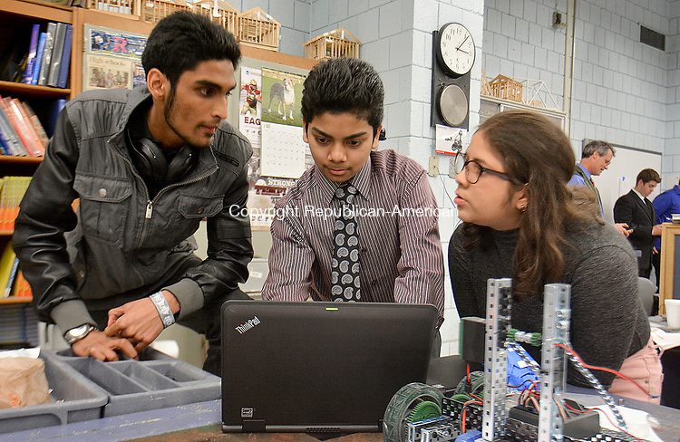 WATERBURY, CT-050517JS10- Crosby High School students, from left, Usamah Sattar; Yodesh Timaul and Andrea Gfellner, work on their project proposal Friday at Crosby High School in Waterbury. The students received help and advice by Gregory N. Polletta, a 1989 graduate of Crosby,  current professor of Engineering and founder of iGNITIATE. The students worked on proposals that will be presented to Sikorsky. The teams developed a product and worked engineering, production, out price points, funding and profits. <br /> Jim Shannon Republican-American