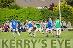 Kilcummin's Kevin McCarthy gets away from KOR's Shane Brosnan, David McLoughlin, Danny O'Sullivan and John C. O'Connor in the Credit Union County Senior Football League Div. 1 Kerins O'Rahilys Vs Kilcummin at Strand Road GAA Ground on Friday