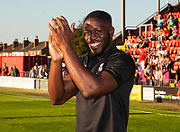 Lincoln City's John Akinde acknowledges the fans before kick off<br /> <br /> Photographer Andrew Vaughan/CameraSport<br /> <br /> Football Pre-Season Friendly - Lincoln City v Norwich City - Tuesday 10th July 2018 - Sincil Bank - Lincoln<br /> <br /> World Copyright &copy; 2018 CameraSport. All rights reserved. 43 Linden Ave. Countesthorpe. Leicester. England. LE8 5PG - Tel: +44 (0) 116 277 4147 - admin@camerasport.com - www.camerasport.com