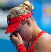 ANGELIQUE KERBER (GER) against MARIA SHARAPOVA (RUS) in the third round of the Women's Singles. Maria Sharapova beat Angelique Kerber 6-1 6-2 ..21/01/2012, 21st January 2012, 21.01.2012..The Australian Open, Melbourne Park, Melbourne,Victoria, Australia.@AMN IMAGES, Frey, Advantage Media Network, 30, Cleveland Street, London, W1T 4JD .Tel - +44 208 947 0100..email - mfrey@advantagemedianet.com..www.amnimages.photoshelter.com.