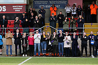 Friends and family on the touchline during a minute of applause in memory of Jodie Chesney during Dagenham & Redbridge vs Bromley, Vanarama National League Football at the Chigwell Construction Stadium on 9th March 2019