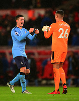 Goalkeeper of Newcastle  Karl Darlow and Ciaran Clark of Newcastle celebrate after their win during the EPL - Premier League match between Stoke City and Newcastle United at the Britannia Stadium, Stoke-on-Trent, England on 1 January 2018. Photo by Bradley Collyer / PRiME Media Images.