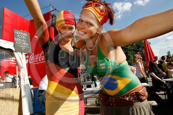 BERLIN - GERMANY 9. JULY 2006 -- At the opening match of the World-Cup Germany played against Costa Rica.. in Picture two young women with body paint in Brazilian and German colours -- PHOTO: UFFE NOEJGAARD / EUP-IMAGES.