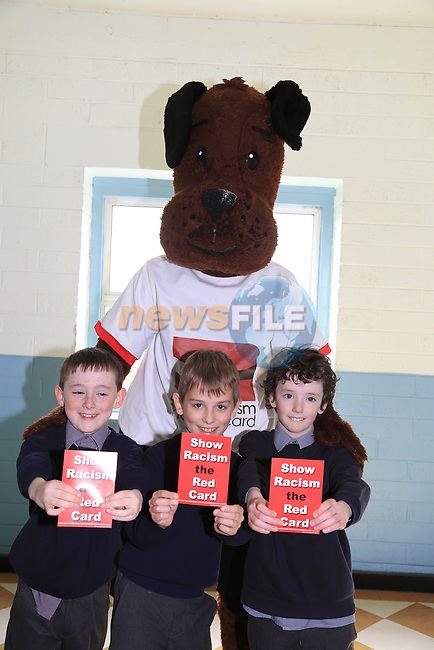 Tadhg Plunkett, Dawid Gajda and Sam Reynolds.students in St Josephs CBS with Jeff the ref part of the Show Racism the Red Card Workshop featuring Jeff the Ref.Picture: Fran Caffrey / www.newsfile.ie ..