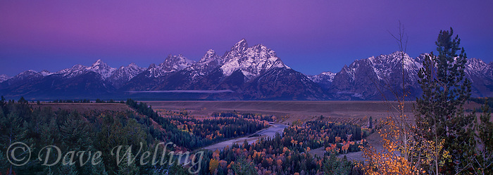 937000023 panoramic fall color graces the aspens as dawn alpenglow lights up the teton range at the snake river overlook grand tetons national park wyoming