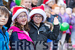 Enjoying the CH Chemist, Tralee, Christmas parade, on Saturday afternoon last were l-r: Caoimhe and Gearoid Corcoran, Tralee.