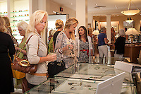 Shoppers sip cocktails, take part in drawings, and browse Fall Fashions during Fashion's Night Out at Marissa Collections on Third Street South, Naples, Florida, USA, Sept. 8, 2011. Photo by Debi Pittman Wilkey.