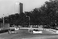 COLUMBUS, OH - OCTOBER 6: The Budweiser/Dyson Racing Porsche 962 101 driven by Price Cobb and Drake Olsen leads a pair of prototype cars en route to victory in the Columbus Ford Dealers 500 IMSA GTP/Lights race at the temporary Columbus Street Circuit in Columbus, Ohio on October 6, 1985. (Photo by Bob Harmeyer)