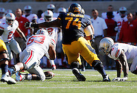 Ohio State Buckeyes defensive lineman Michael Bennett (63) recovers a California Golden Bears fumble in the first quarter of the NCAA football game at Memorial Stadium in Berkeley, California,  Saturday afternoon, September 14, 2013. The Ohio State Buckeyes defeated the California Golden Bears 52 - 34. (The Columbus Dispatch / Eamon Queeney)