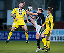 Dundee's Gary Irvine is crowed out by St Mirren's Sean Kelly and Lewis McLear.