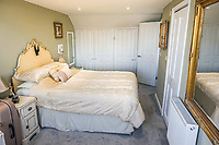 BNPS.co.uk (01202 558833)<br /> Pic: PurpleBricks/BNPS<br /> <br /> Bedroom. <br /> <br /> This £475,000 seaside cottage contains a charming secret – it's built around two Victorian railway carriages.<br /> <br /> The 19th century carriages were used as temporary housing for soldiers returning from the First World War when there was a shortage of homes.<br /> <br /> But many of them remained in place years later and had bricks and mortar built around them.<br /> <br /> And so from the street view they looked like normal houses but inside the main reception rooms were with the converted carriages.