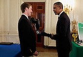 United States President Barack Obama shakes hands with a robotic arm, created and presented by second place winner at International Science and Engineering Fair, Easton LaChappelle, from Mancos Colorado in the  State Dining Room of the White House in Washington, D.C. during the White House Science Fair on April 22, 2013. The White House Science Fair celebrates the student winners of a broad range of science, technology, engineering and math (STEM) competitions from across the country. The first White House Science Fair was held in late 2010.<br /> Credit: Aude Guerrucci / Pool via CNP