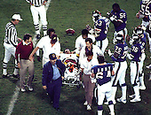 New York Giants players look on as Washington Redskins quarterback Joe Theismann (7) is carried off the field on a stretcher after suffering a career-ending injury at RFK Stadium in Washington, D.C. on Monday, November 18, 1985. Theismann suffered a career-ending injury on the play.  The Redskins won the game 23 - 21..Credit: Arnie Sachs / CNP