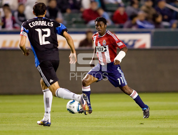 CD Chivas USA midfielder Michael Lahoud (11) attempts to move past  San Jose Earthquakes defender Ramiro Corrales (12). CD Chivas USA defeated the San Jose Earthquakes 3-2 at Home Depot Center stadium in Carson, California on Saturday April 24, 2010.  .