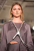 Collection by Holly Glover from Edinburgh College of Art. Graduate Fashion Week 2014, Runway Show at the Old Truman Brewery in London, United Kingdom. Photo credit: Bettina Strenske