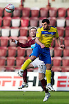 Hearts v St Johnstone...05.02.12.. Scottish Cup 5th Round.Callum Davidson gets above Stephen Elliott.Picture by Graeme Hart..Copyright Perthshire Picture Agency.Tel: 01738 623350  Mobile: 07990 594431