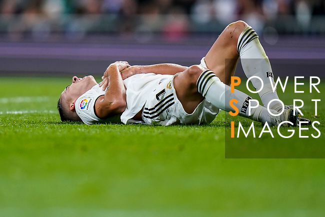 Lucas Vazquez of Real Madrid lies injured on the pitch during the La Liga 2018-19 match between Real Madrid and Rayo Vallencano at Estadio Santiago Bernabeu on December 15 2018 in Madrid, Spain. Photo by Diego Souto / Power Sport Images
