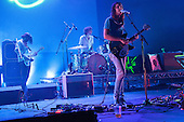 Tame Impala - L-R: Cam Avery, Julien Barbagallo, Kevin Parker - performing live at The Hammersmith Apollo, London UK - 25 June 2013.   Photo credit: Justin Ng/Music Pics Ltd/IconicPix