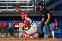 Williamsport Crosscutters catcher Austin Bossart (47) and umpire John Durante during a game against the Batavia Muckdogs on July 15, 2015 at Dwyer Stadium in Batavia, New York.  Williamsport defeated Batavia 6-5.  (Mike Janes/Four Seam Images)